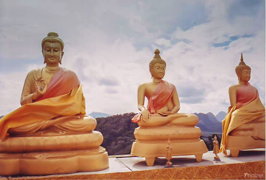 Buddha images high on the mountain at Wat Tham Seua, Krabi