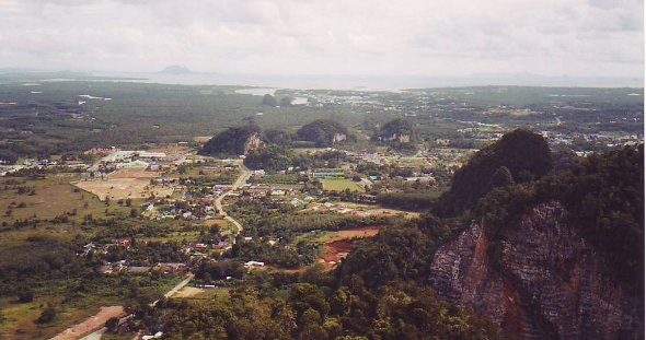 View from mountain on top of Wat Tham Seua looking out to the Andaman Sea in the distance.