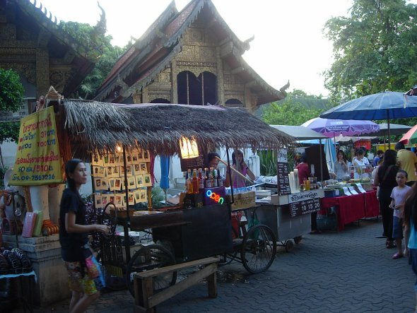 food and soft drink stalls inside temple grounds at Chiang Mai Sunday Market