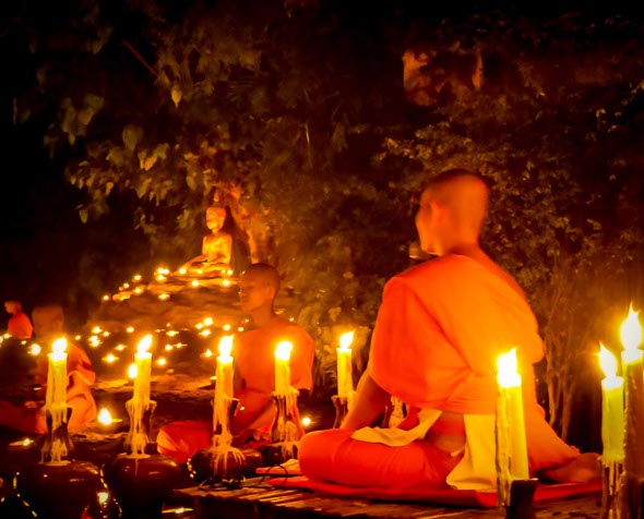 Novice monks meditating on the eve of the Phansa rains retreat