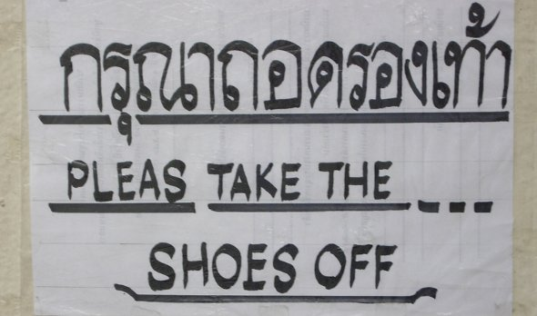 take off shoes sign at temple in Chiang Rai