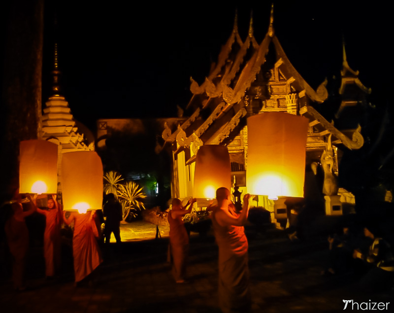 monks prepare to release khom loy sky lanterns in Chiang Mai