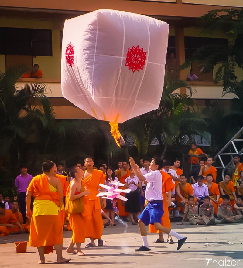 releasing khom fai lanterns in the daytime