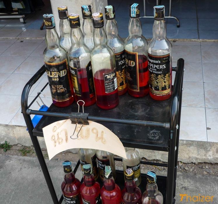 gasoline in whisky bottles in Thailand