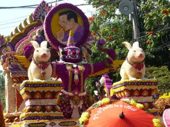 Float at Chiang Mai Flower Festival with floral portrait of King of Thailand and his birth-year animal, the rabbit.