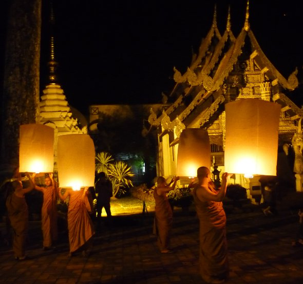 monks at Wat Chedi Luang in Chiang mai prepare to release 'khom loy' sky lanterns