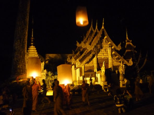 Monks release khom loy sky lanterns at Wat Chedi Luang, Chiang Mai