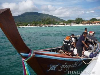 Transferring from speedboat to longtail boat on arrival at Ko Lipe, Thailand