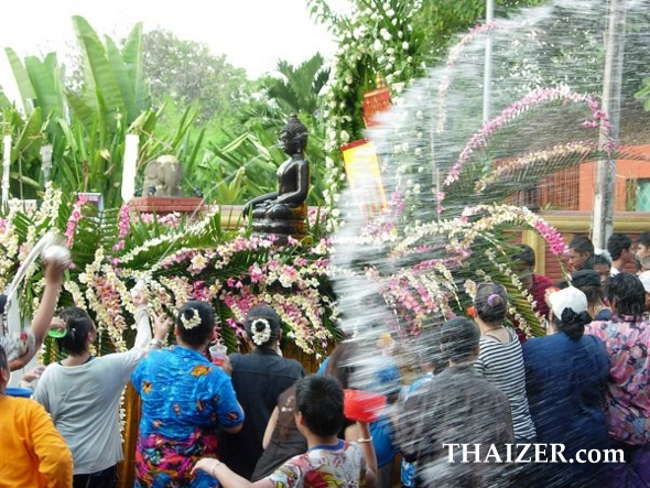 Blessing Buddha images with water during Songkran in Thailand
