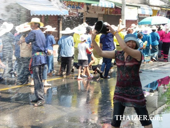 Throwing buckets of water during the Songkran parade