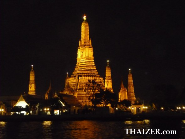 Wat Arun in Bangkok viewed from dinner cruise boat on Chao Phraya River