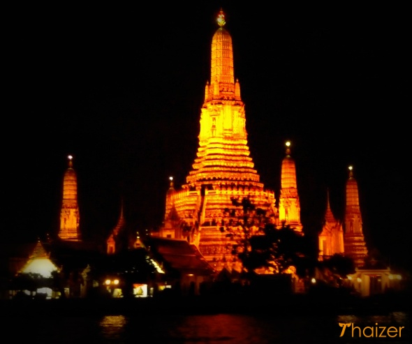 Wat Arun in Bangkok viewed from dinner cruise boat on Chao Phraya River