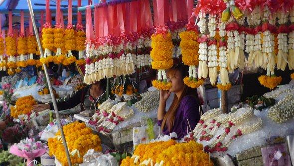 flower garlands for sale at market in Thailand