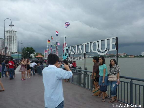 posing by the Asiatique Riverfront sign