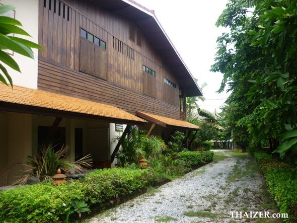 side view of At Home Sukhothai showing garden rooms with covered terrace and upstairs wooden rooms