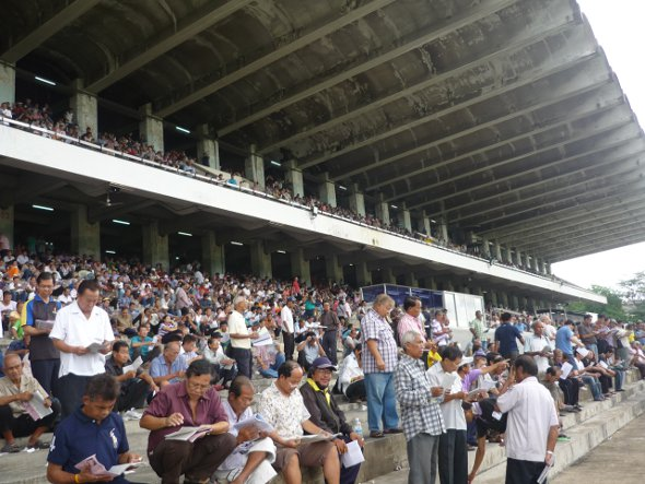 crowds in the stands at the Royal Turf Club, Bangkok
