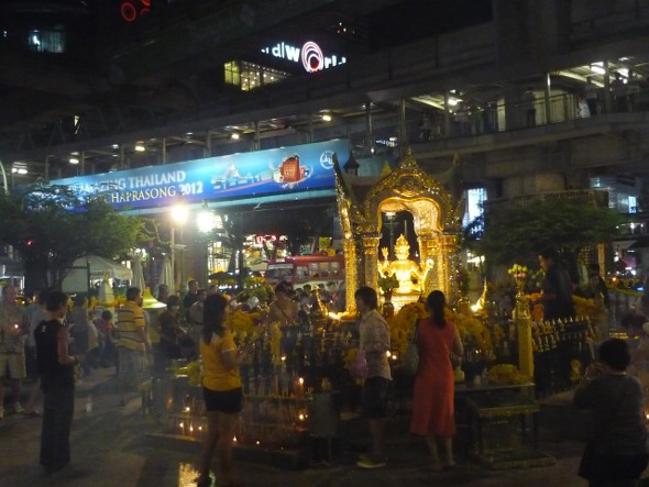 Erawan Shrine in Bangkok with elevated walkway and Central World shopping mall in the background