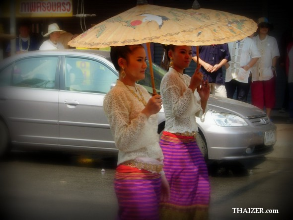 Two Thai ladies carrying parasols during Songkran in Chiang Mai