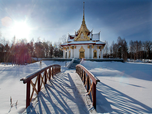 A snow-covered winter scene at the Royal Thai Pavilion in Utanade, Sweden