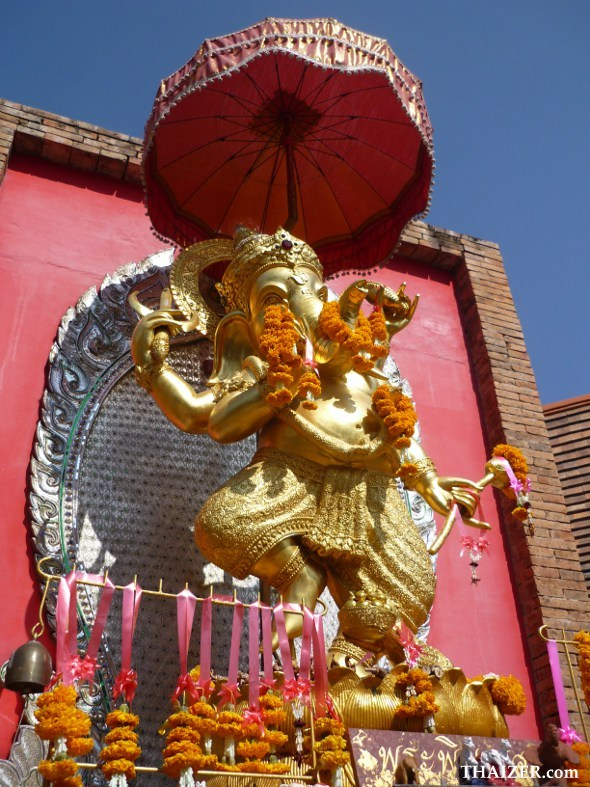 statue of dancing Ganesh outside a business in Chiang Mai