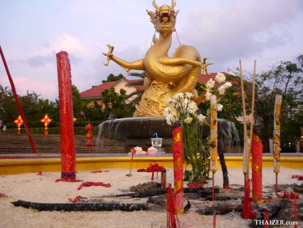 Incense, candles and offerings to honour Hai Leng Ong in Phuket