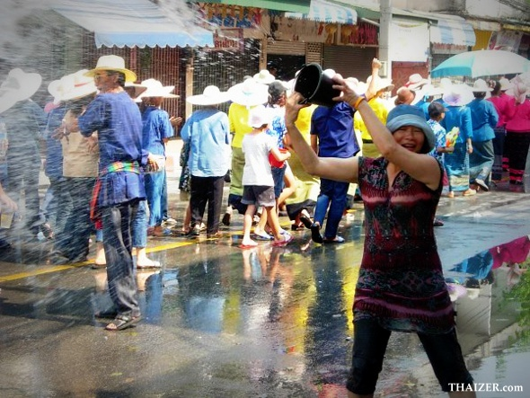 Throwing buckets of water during the Songkran New Year Water Festival
