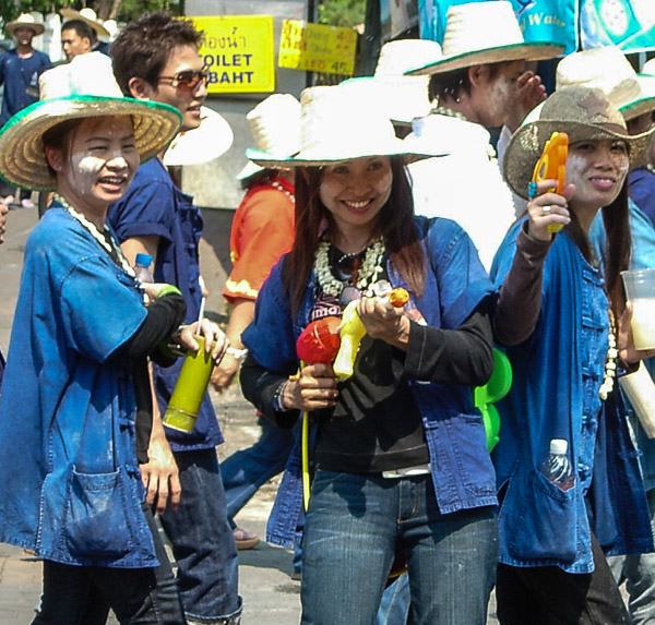 Smiling assassins with water pistols during the Songkran Water Festival
