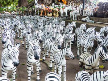 zebras at a roadside shrine in Thailand