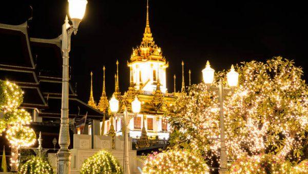 Wat Ratchanada and Loha Prasat illuminated at night