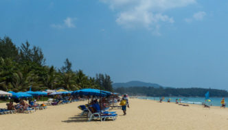 sun loungers and umbrellas on Karon Beach, Phuket